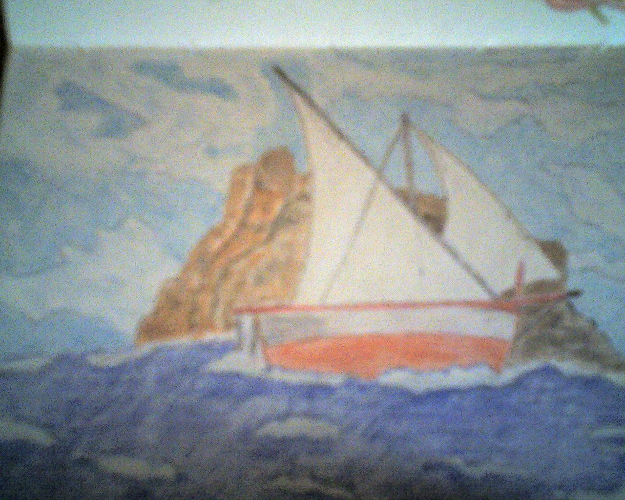 Barca davanti a scoglio