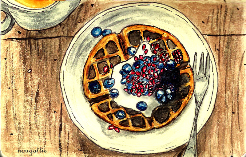Waffles with creme, blueberries, and pomegranate
