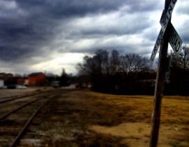 Railroad crossing and foul weather ahead