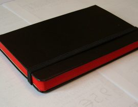 Moleskine red line notebook