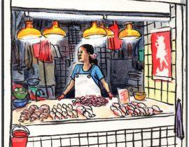 Hong Kong: Fishmonger in Kowloon wet market.