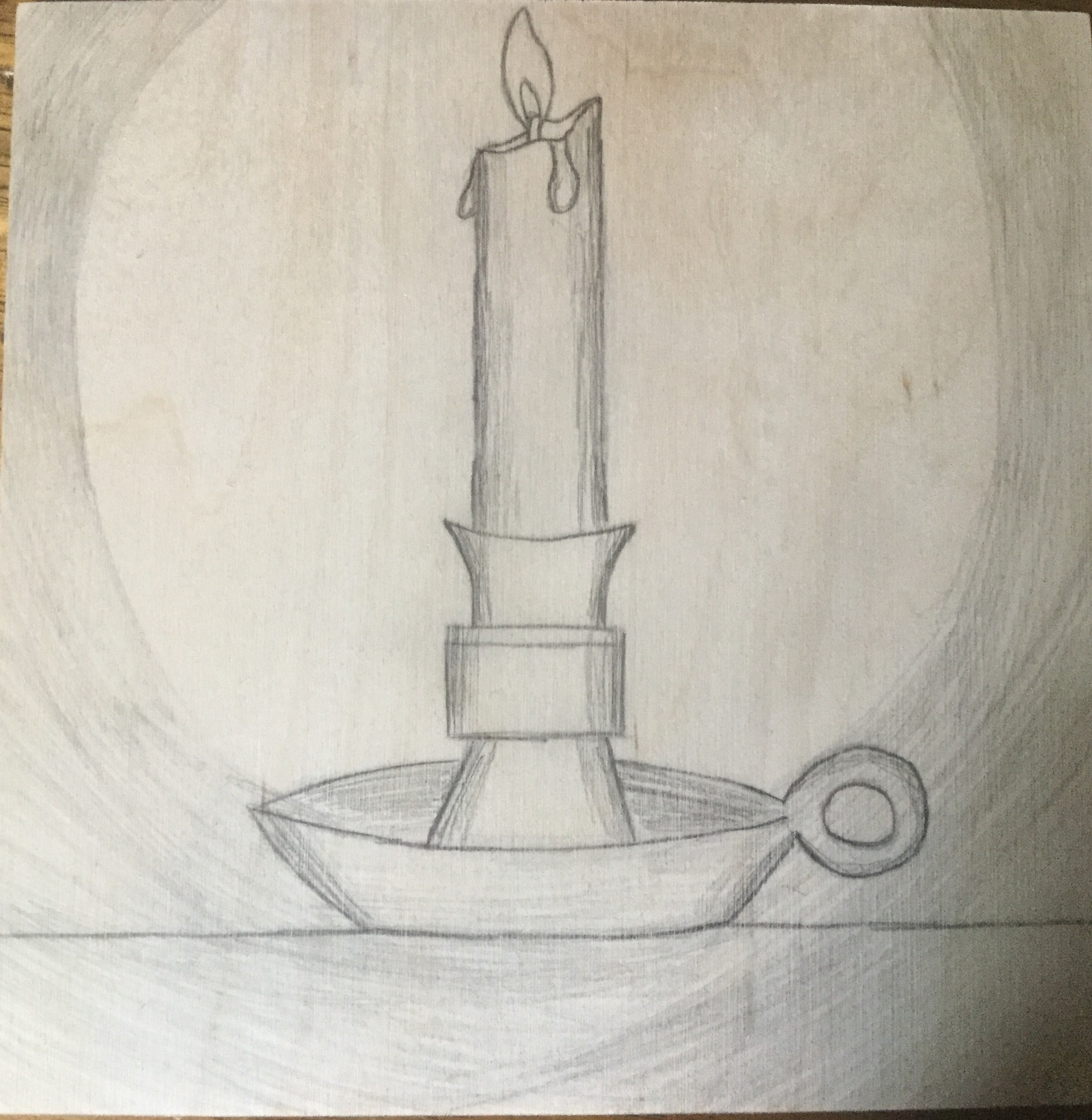 Candle on wood