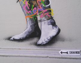 By the feet of a street art piece!