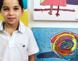 Andre pintando Gustavo Rosa